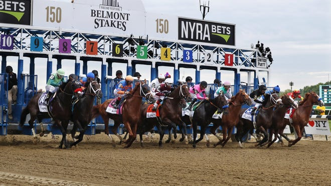Horses break through the starting gate at the beginning of the 150th running of the Belmont Stakes horse race on June 9, 2018, in Elmont, N.Y. The 152nd running is scheduled for Saturday.