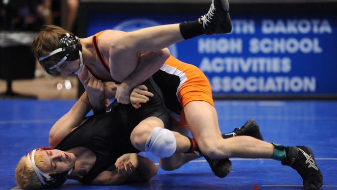 Huron's Wyatt Shillingstad wrestles Sturgis' Bailey Bengle during the first round matches in the 120-pound weight class at the  Class A state tournament in February.