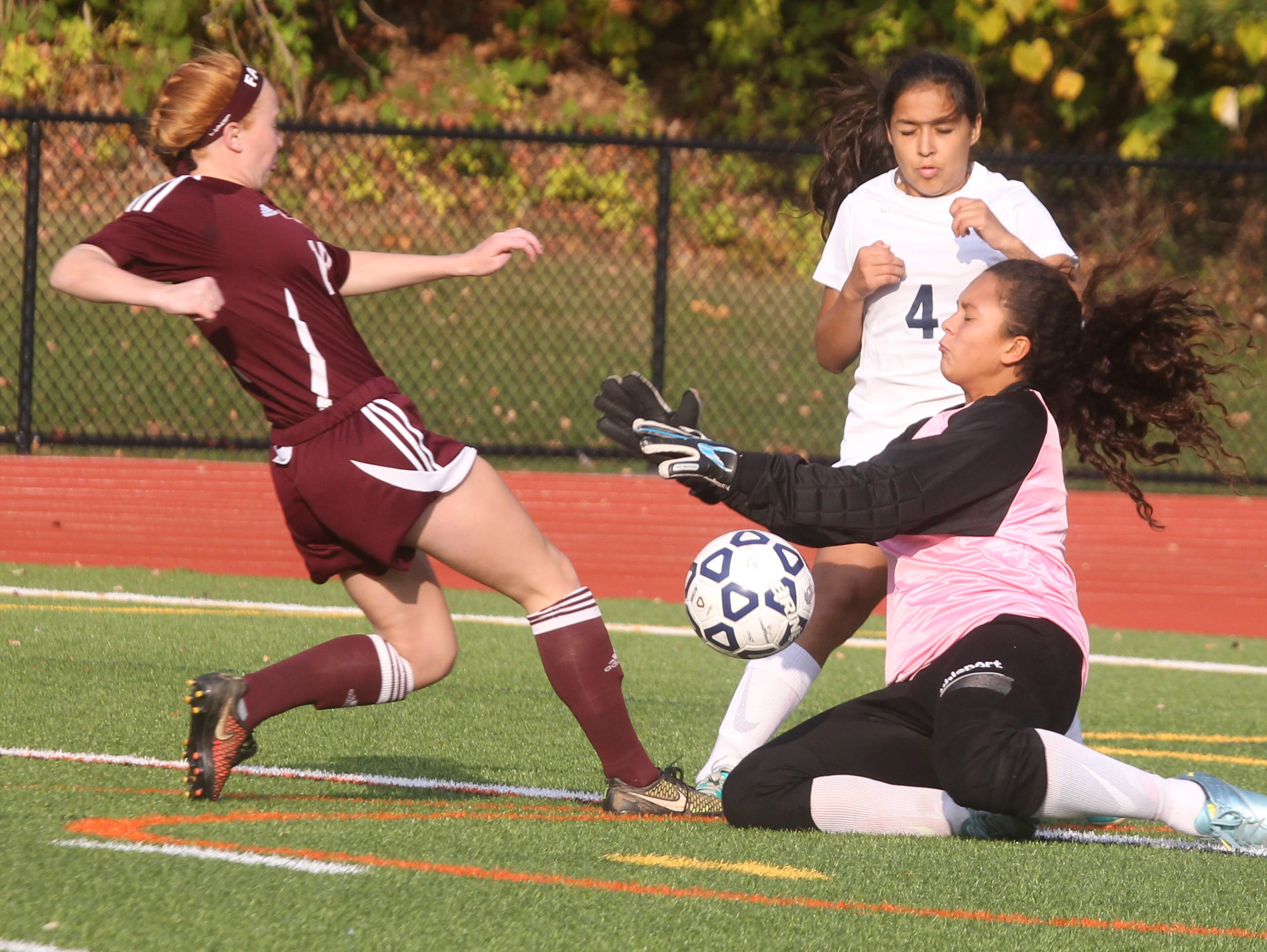 Albertus Magnus' Carly Clinton is stopped by Briarcliff goalie Khassandra Muniz during their game at Briarcliff Oct. 8, 2015.