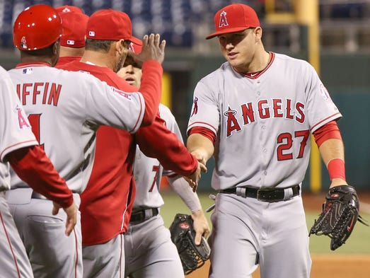 Mike Trout congratulates his teammates after the Angels 4-3 win over the Phillies.