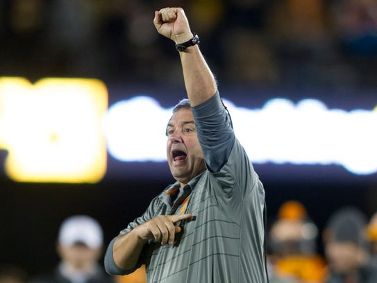Assistant Coach Brady Hoke calls during a game between