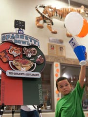 Makiy Hale, 5, shows his Tyger pride at the Spaghetti