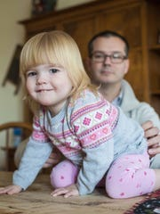 Tilly McCarthy and her father Brian at home in Swanton on Thursday, December 10, 2015. Tilly suffers from cystic fibrosis. The McCarthys are losing their local pediatrician, in part because of the low rate of Medicaid reimbursements. Four of eleven pediatricians in Franklin County are leaving their practices.