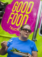 Dana Corey enjoys a free dinner from the Chittenden Emergency Food Shelf 's Good Food truck at the Northgate Apartments in Burlington on Wednesday, May 25, 2016.
