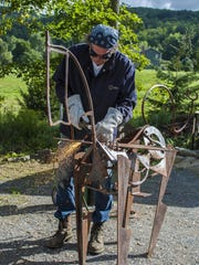 Sculptor Gerald K. Stoner at work in Underhill on August