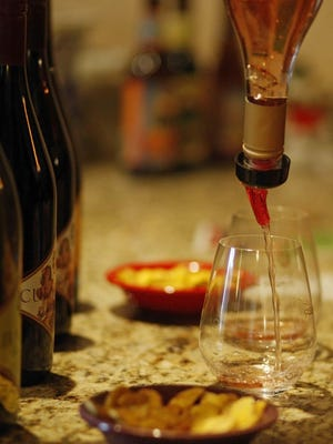 A taste is poured at Cubanismo Vineyards.