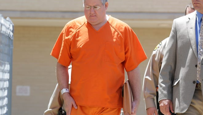 Bernie Tiede is led into the Panola County court house by law enforcement officials in Carthage, Texas, Tuesday, May 6, 2014. The former mortician serving a life sentence for the death of a rich East Texas woman could soon go free with the agreement of the district attorney who prosecuted him. Tiede, whose case inspired the Matthew McConaughey movie ?Bernie,? is expected in court in Carthage, Texas. (AP Photo/LM Otero)
