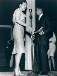 Patsy Cline  receives an award from Charlie Lamb, publisher