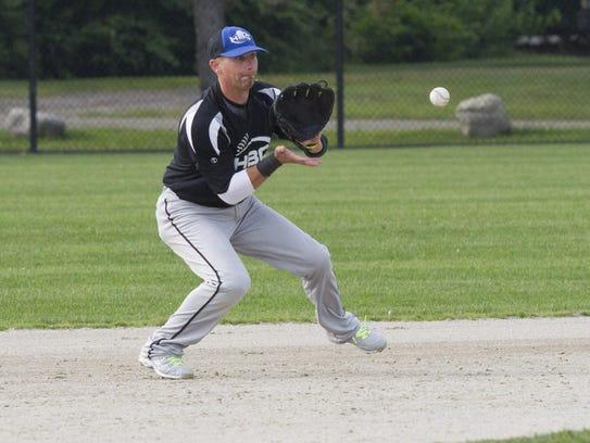 Kyle Kracht of HBC Behnke's fields a ball during a
