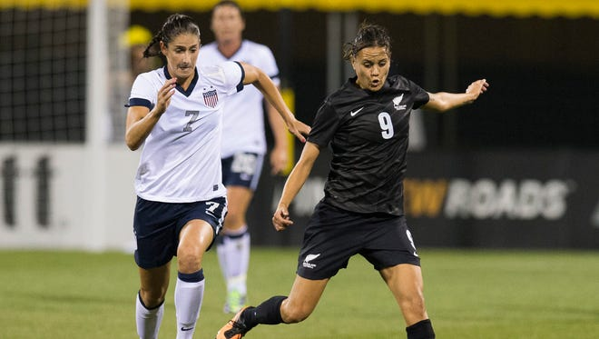 New Zealand forward Amber Hearn (9) plays the ball forward under pressure from USA midfielder Yael Averbuch (7) at Columbus Crew Stadium. The match ended in a 1-1 tie.