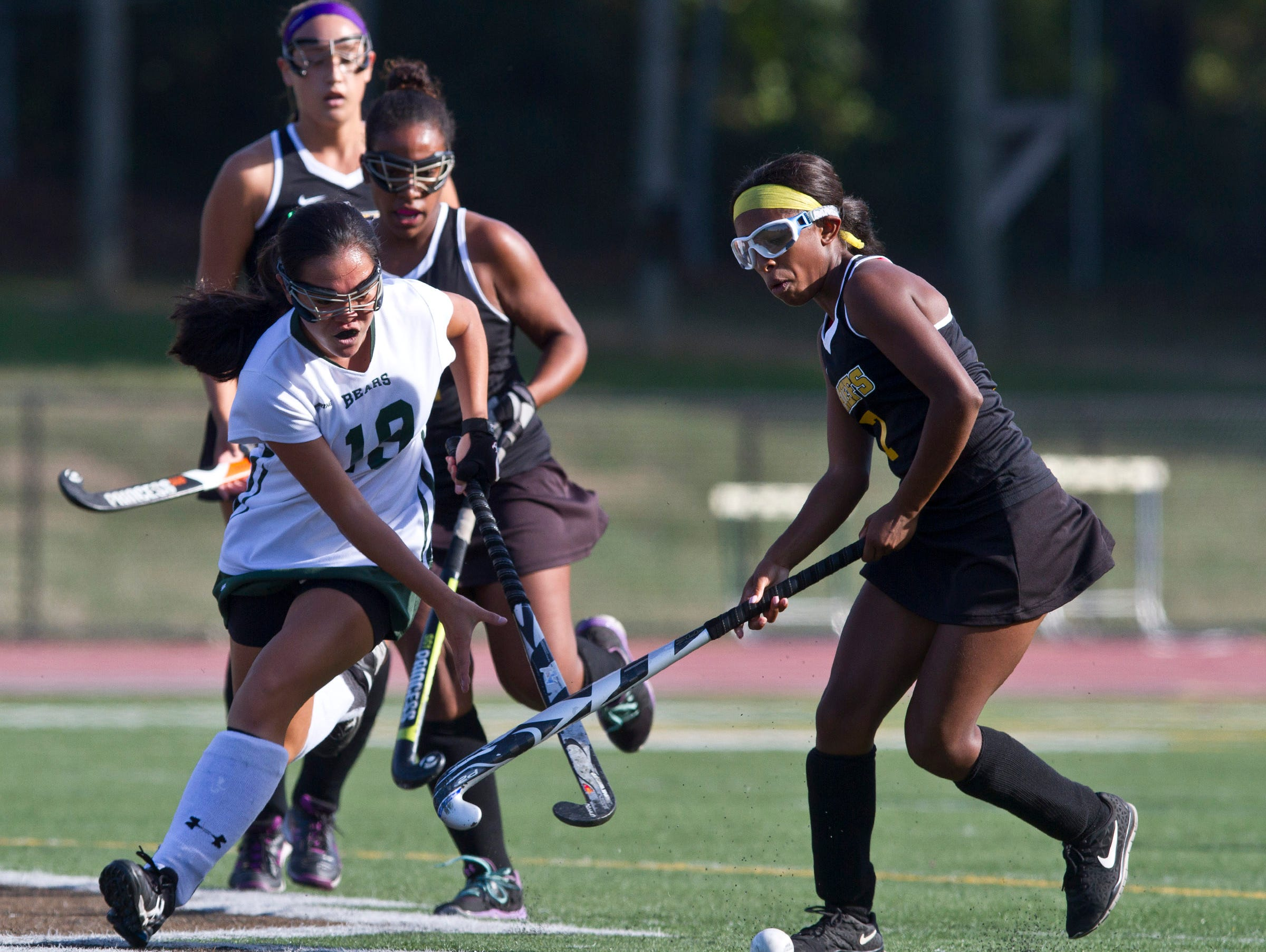 East Brunswick's Sydney Huang drives the ball past Piscataway's Dominique Nelson. Piscataway vs East Brunswick field hockey. 72670492 East Brunswick, NJ Thursday, September 24, 2015 @dhoodhood