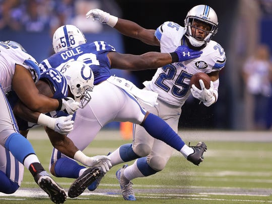 Detroit Lions running back Theo Riddick (25) slips by Indianapolis Colts outside linebacker Trent Cole (58) in the second half of their game Sunday, September 11, 2016, afternoon at Lucas Oil Stadium. The Colts lost to the Lions 39-35.