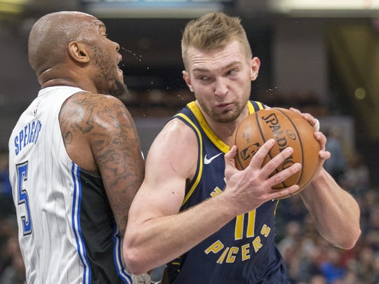Domantas Sabonis of Indiana turns into a block by Marreese Speights of Orlando Magic, who was called on a foul during first half action at Indiana Pacers, Bankers Life Fieldhouse, Indianapolis, Monday, Nov. 27, 2017.