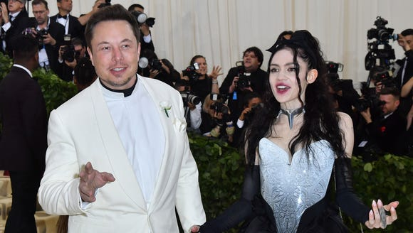 Elon Musk and Grimes arrive for the 2018 Met Gala on