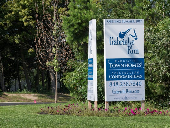 Sales sign outside of Gabrielle Run development being