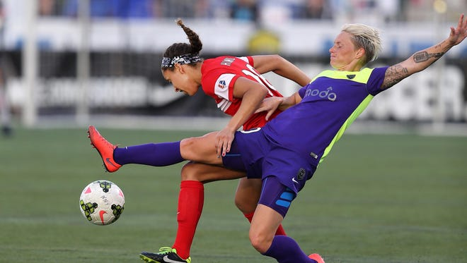 WNY Flash's Jaelene Hinkle ties up Seattle's Jessica Fishlock while fighting for a loose ball on July 3, 2015.