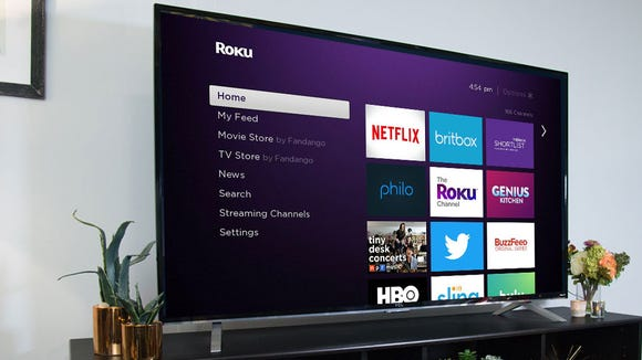 A television displaying the Roku homescreen