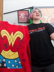 Army veteran Mary Dague shows her Wonder Woman shirt