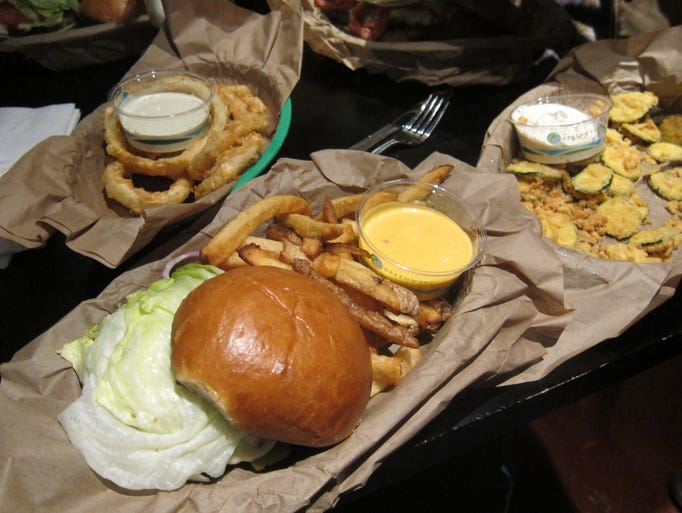 Burgers are served on excellent domed brioche-style buns, the fries are very good, and all sides are served with 1 of 20 sauces: shown here is Mango Chutney with the fries, Jalapeno Ketchup with the onion rings and Parmesan Peppercorn with the zucchini chips.