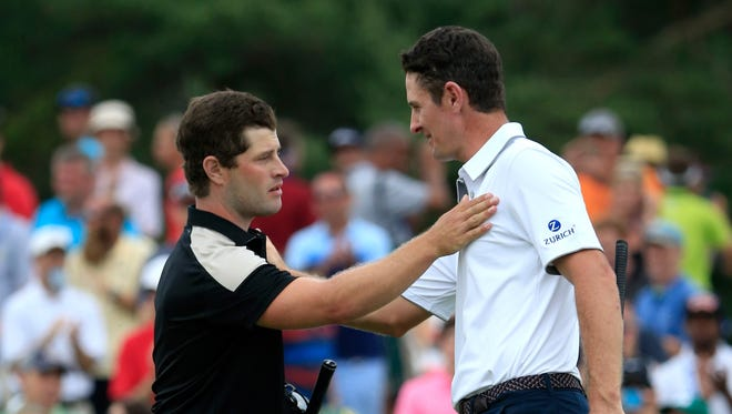 David Lingmerth of Sweden, left, and Justin Rose of England congratulate each other after Lingmerth won The Memorial Tournament presented by Nationwide at Muirfield Village Golf Club on June 7, 2015 in Dublin, Ohio.