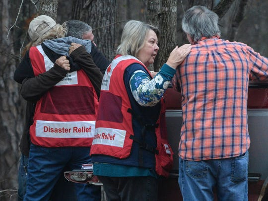 A Red Cross worker hugs the boyfriend of a woman who died in a fire on 909 Shirley Store Road in Anderson on Tuesday.