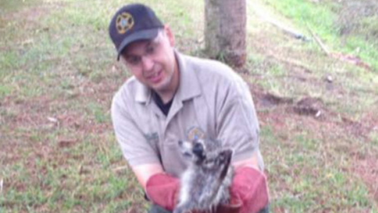 Officer Christopher Hahn after freeing the raccoon.