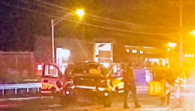 A digitally-enhanced photo of the scene late Saturday night on Route 37 in Toms River, where an Ocean County sheriff's car was involved in a motor vehicle crash.
