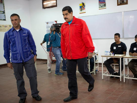 Venezuela's President Nicolas Maduro arrives at a polling