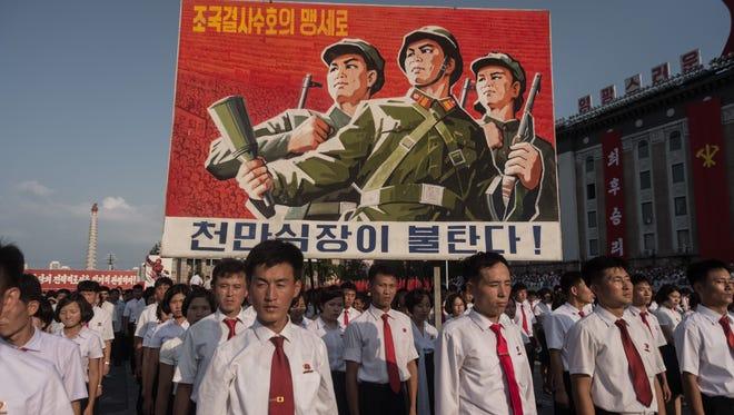 A propaganda poster is displayed during a rally in support of North Korea's stance against the U.S., on Kim Il-Sung square in Pyongyang on Aug. 9, 2017.