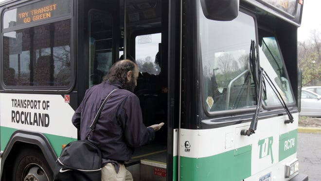 Carmine DiMeglio of Monsey boards a Rockland TOR bus at the Nanuet Mall April 14, 2009.  Fares are going up May 1.  (Vincent DiSalvio / The Journal News)