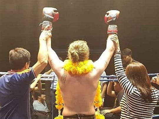 Dylan Campbell celebrates a win in his first ever Muay Thai match on July 26 in Bangkok, Thailand.