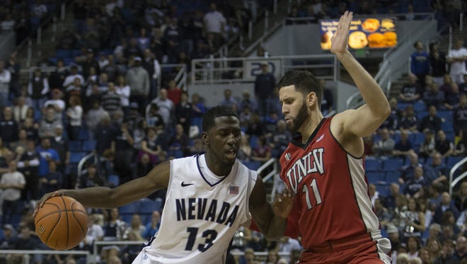 Nevada's Cole Huff against UNLV's Carlos Lopez-Sosa during their basketball game played at Lawlor Events Center on Saturday night, March 8, 2014, in Reno, Nevada.