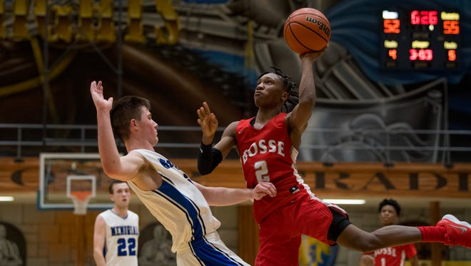 Bosse's Mekhi Lairy (2) shoots over Memorial's Branson Combs (3) during their SIAC semifinal tournament game at Castle High School Thursday night.