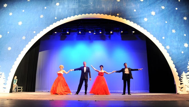 Maddie Beer, Brian Hupp, Madeline Carter, and Ryan Shreve sing and dance during a dress rehearsal Friday evening for White Christmas at Renaissance Theatre.