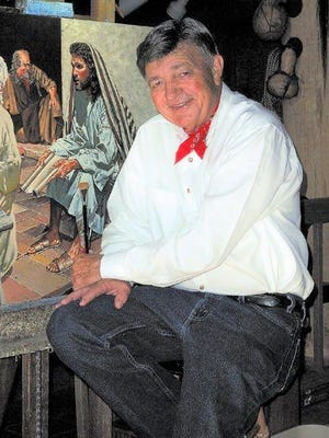 Kenneth Wyatt sits at his easel.