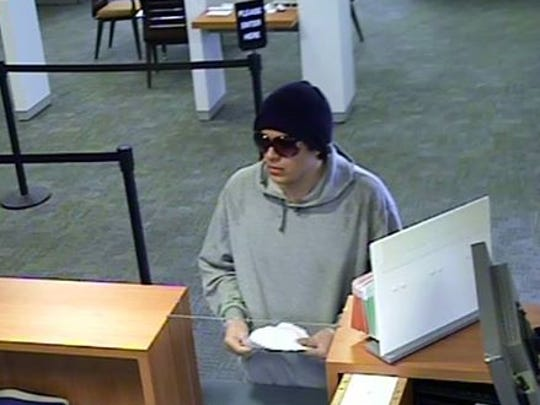 Police say this surveillance image shows Nicholas Cavaliero robbing a bank in Lumberton on March 7.