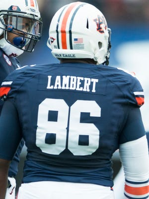 Defensive end DaVonte Lambert leads Auburn with 3 1/2 sacks and is out for the year.