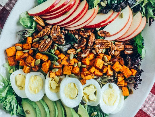 Autumn Cobb Salad is adorned with Cider Honey Mustard