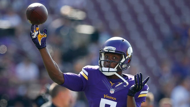 Minnesota Vikings quarterback Teddy Bridgewater (5) throws a pass in practice before the game with the Atlanta Falcons at TCF Bank Stadium.