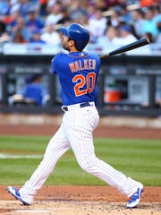 Mets second baseman Neil Walker (20) watches his two