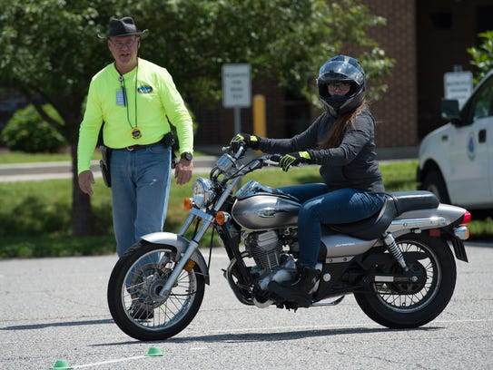 Clayton Porter, left, a certified motorcycle safety