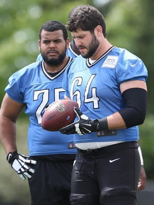 Travis Swanson (No. 64) and Larry Warford will team at center and right guard respectively.