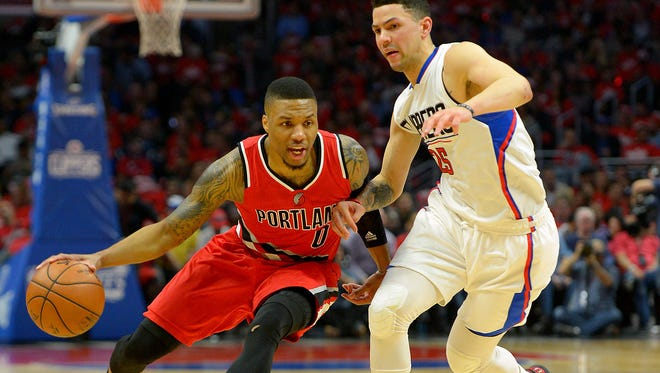 Los Angeles Clippers guard Austin Rivers (25) guards Portland Trail Blazers guard Damian Lillard (0) in the first half of  Game 5.