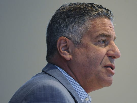 Auburn basketball coach Bruce Pearl speaks at a Public