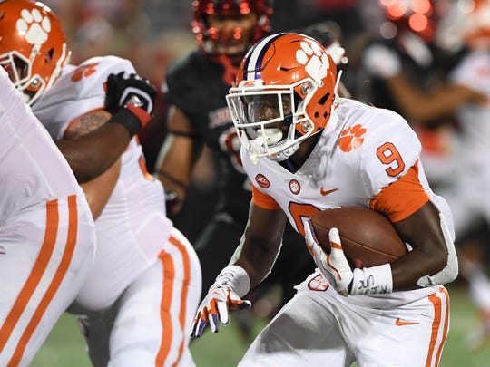 Clemson running back Travis Etienne (9) breaks free to score on an 81 yard TD against Louisville during the 4th quarter on Saturday, September 16, 2017 at Louisville's Papa John's Cardinal Stadium.