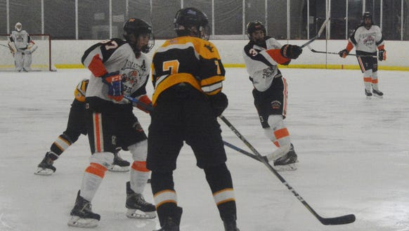 Mamaroneck  forward Michael Torre (right) blasts a