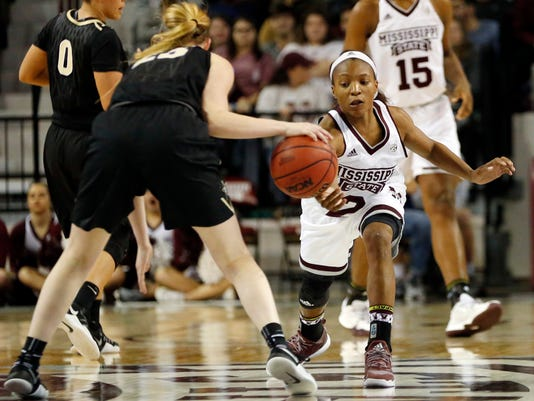 Mississippi State guard Morgan William (2) attempts to steal from Vanderbilt guard Minta Spears (23) in the first half of an NCAA college basketball game in Starkville, Miss., Thursday, Feb. 9, 2017. (AP Photo/Rogelio V. Solis)