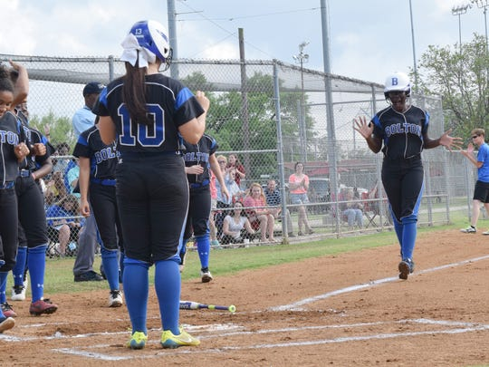 Bolton's Destiny Williams (32, far right) excitedly heads for home plate after hitting a two-run home run that also brought in Lauren Fowler (10, left) in Bolton's game against Jewel Sumner held Friday.