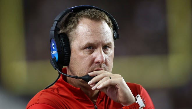 Ole Miss coach Hugh Freeze hired North Carolina assistant Tray Scott as his defensive line coach.