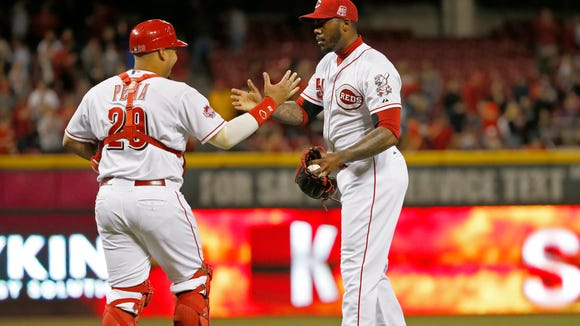 Reds closer Aroldis Chapman (right) and catcher Brayan
